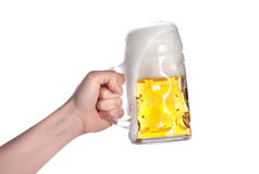 Hand holding beer making a toast. On a white stock images