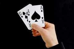 Hand holding best classic blackjack combination ten and ace of s Royalty Free Stock Images