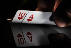 hand holding best classic winning blackjack combination ten and ace stock photos