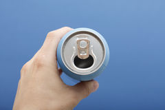 Hand holding beverage can stock photo