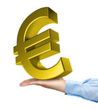 Hand holding big golden euro symbol. Isolated Royalty Free Stock Photo