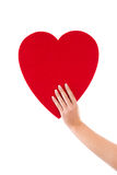 Hand holding a big heart shape made from paper for greeting card Stock Photos