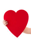 Hand holding a big heart shape made from paper for greeting card Stock Photo