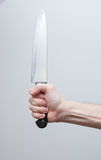 Hand holding big knife Stock Images