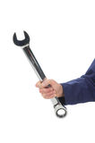 Hand holding big wrench Stock Image