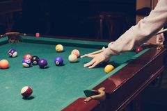 Hand holding billiard stick cue ready to shot ball. Hand holding billiard stick cue on a pool table ready to shot the ball stock photography