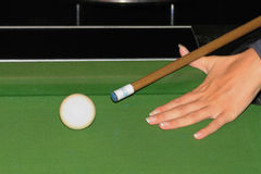 Hand holding billiards cue and aiming at the ball Stock Images