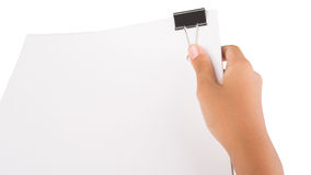 Hand Holding Binder Clip And White Paper III stock images