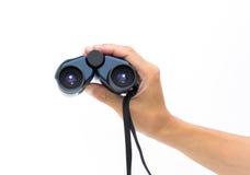 Hand holding a binoculars Stock Image