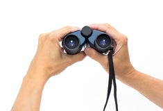 Hand holding a binoculars Stock Photo
