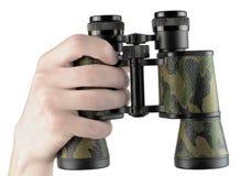 Hand holding binoculars. A hand holding military binoculars stock image