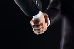 Hand holding on black background Stock Image