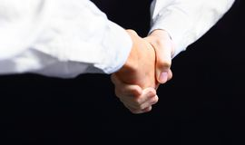 Hand holding on black background Royalty Free Stock Image