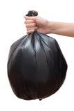 Hand holding black bag Stock Photography