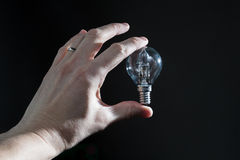 Hand holding a black bulb isolated Royalty Free Stock Image
