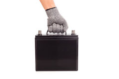 Hand holding black car battery isolated on white background Royalty Free Stock Image