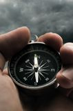 Hand holding black compass Royalty Free Stock Photos