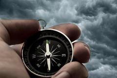 Hand holding black compass Royalty Free Stock Photo