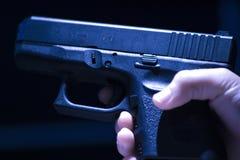 Hand holding black gun Royalty Free Stock Images