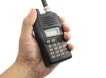Hand holding black ham radio Stock Photos