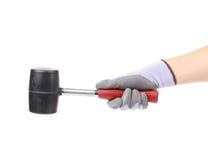 Hand holding black hammer. Stock Image