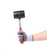 Hand holding black hammer. Royalty Free Stock Image