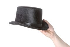 Hand holding a black hat Stock Photography