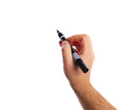 Hand holding a black marker with copy space. Stock Image