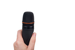 Hand holding black microphone isolated Royalty Free Stock Photography
