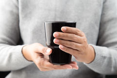 Hand holding  black mug. Stock Photography
