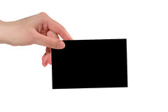 Hand holding a black paper card Royalty Free Stock Photography
