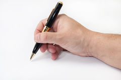 Hand holding black pen and writing Royalty Free Stock Photo