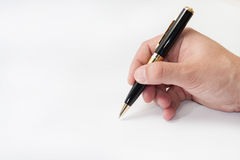 Hand holding black pen and writing Stock Images