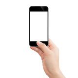 Hand holding black phone isolated clipping path inside ima Royalty Free Stock Images
