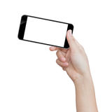 Hand holding black phone isolated clipping path inside Stock Image