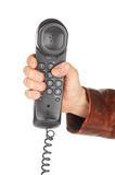 Hand holding black phone tube. On white background Royalty Free Stock Images
