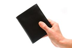 Hand holding black pocketbook Royalty Free Stock Photos