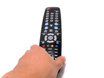 Hand holding a Black Remote control , Vertical Stock Photography