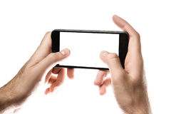Hand holding Black Smartphone with blank screen on white backgro Royalty Free Stock Photography
