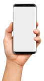 Hand holding Black Smartphone with blank screen on white Stock Photography