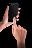 Hand holding Black Smartphone with blank screen Stock Photo