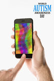 Hand holding Black Smartphone with color screen on white backgro Stock Images