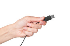 Hand holding black USB cable Stock Photos