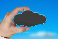Hand holding blank black cloud with nature blue sky Royalty Free Stock Images