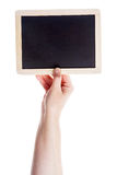 Hand holding blank blackboard Royalty Free Stock Images