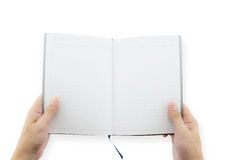 Hand holding blank book in the hand. Man show pages. Stock Photos