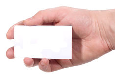 Hand holding blank business card. On white background Stock Photography