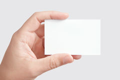 Hand holding blank business card Royalty Free Stock Image