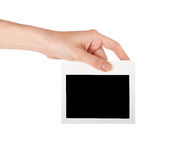 Hand holding a blank business card. Female hand holding a blank business card, studio isolated Stock Photo