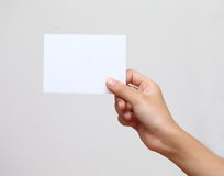 Hand holding blank business card Stock Photography